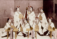 0075956 © Granger - Historical Picture ArchiveJAPAN: PERFORMERS, c1885.   Miko, or Shinto shrine maidens, performing a dance at a temple. Hand-tinted albumen photograph by Farsari & Co., 1885-1900.