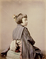 0075964 © Granger - Historical Picture ArchiveJAPAN: YOUNG GIRL, 1880s.   An eight-year-old girl wearing a traditional Japanese obi. Hand-tinted albumen photograph by Farsari & Co., 1885-1900.