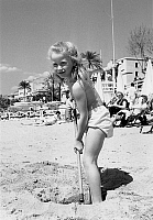 0136893 © Granger - Historical Picture ArchiveBRIGITTE FOSSEY.   Brigitte Fossey at cannes film festival on april 18, 1953 on the beach. Full credit: AGIP - Rue des Archives / Granger, NYC -- All rights reserved.
