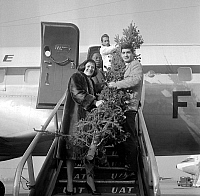 0138780 © Granger - Historical Picture ArchiveCOLETTE RENARD AND JEAN CLAUDE BRIALY.   Colette Renard and Jean Claude Brialy accompanying president of Central African Republic, Barthelemy Boganda, at Bourget airport to give Christmas tree to african children, december 2, 1958. Full credit: AGIP - Rue des Archives / Granger, NYC -- All rights re