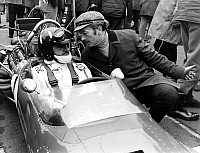 0138788 © Granger - Historical Picture ArchiveCOLIN CHAPMAN.   Colin Chapman designer of the Lotus cars chats with his N° 1 driver Graham Hill who won 100 bottles of champagne for setting up the fastest time in practice as they wait for the start of the Race of Champions march 16, 1969. Full credit: AGIP - Rue des Archives / Granger, NYC -- All Rights Reserved.