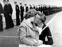 0139165 © Granger - Historical Picture ArchiveCOUPLE D' AMOUREUX.   Young Shirley Kerrigan and her fiancee John Godley after a year of separation on the aircraft carrier Centaure in Plymouth harbour on april 28, 1960. Full credit: AGIP - Rue des Archives / Granger, NYC -- All rights re