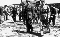 0139708 © Granger - Historical Picture ArchiveDE GAULLE AND GIRAUD, 1943.   General Charles de Gaulle meeting General Henri Giraud on his arrival on airfield in Algiers may 30, 1943 during the war for joint presidency of the French National Liberation Committee. Full credit: AGIP - Rue des Archives / Granger, NYC -- All rights reserved.