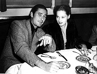 0141130 © Granger - Historical Picture ArchiveERROL FLYNN.   Errol Flynn (1909-1959) and his2nd wife Nora Eddington at restaurant c. 1945. Full credit: AGIP - Rue des Archives / Granger, NYC -- All rights reserved.
