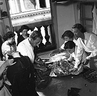 0146091 © Granger - Historical Picture ArchiveJACQUES FATH.   French fashion designer Jacques Fath (1912-1954) in his workshop in august 1949 in Paris with design assistants. Full credit: AGIP - Rue des Archives / Granger, NYC -- All Rights Reserved.