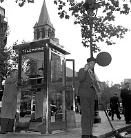 0149069 © Granger - Historical Picture ArchiveFIRST TELEPHONE BOOTH.   First telephone booth on a public highway in Paris 5 October, 1955. Full credit: AGIP - Rue des Archives / Granger, NYC -- All rights reserved.