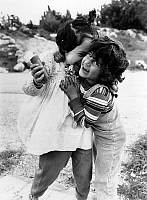 0150321 © Granger - Historical Picture ArchiveLE VILLAGE OF NEVE SHALOM.   Neve Shalom village in Israel where jews and Arabs leave together : children Laila Nasaar and Sidi Frisch on march 13, 1988. Full credit: AGIP - Rue des Archives / Granger, NYC -- All rights reserved.