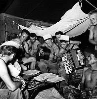 0150361 © Granger - Historical Picture ArchiveFRENCH FOREIGN LEGION, 1955.   Paratroopers of French Foreign Legion relax at Batna Camp in Algeria on august 31, 1955. Full credit: AGIP - Rue des Archives / Granger, NYC -- All Rights Reserved.
