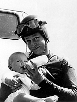 0155740 © Granger - Historical Picture ArchiveMOTARD AND SON FILS.   motorcyclist bottle-feeding his baby, may 28, 1969. Full credit: AGIP - Rue des Archives / Granger, NYC -- All Rights Reserved.