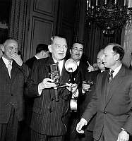 0158967 © Granger - Historical Picture ArchiveRENE COTY (WITH UN ROLLEIFLEX) AND ROBERT COHEN.   French president Rene Coty borrows the camera (Rolleiflex with flash) of Robert Cohen photographer and founder of AGIP photo agency, in Paris 3 January 1959. Full credit: AGIP - Rue des Archives / Granger, NYC -- All rights reserved.