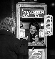 0160895 © Granger - Historical Picture ArchiveSTAND OF THE LOTERIE NATIONALE.   Woman buying a lottery ticket on friday 13 at a national lotery stand in 1953. Full credit: AGIP - Rue des Archives / Granger, NYC -- All rights r