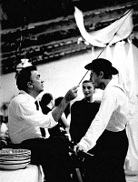 0170644 © Granger - Historical Picture ArchiveFELLINI AND MASTROIANNI.   Federico Fellini directing Marcello Mastroianni on set of the film '8 1/2'. Photograph, 1962. Full credit: Claude Schwartz - Rue des Archives / Granger, NYC -- All Rights Reserved.