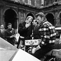 0170794 © Granger - Historical Picture ArchiveJOHNNY HALLYDAY (1943-).  French singer Johnny Hallyday, his secretary Jean Pierre Pierre Bloc and Johnny Stark (l) on set of the film 'Where Are You From, Johnny?.' Photograph, 1963. Full credit: Claude Schwartz - Rue des Archives / Granger, NYC -- All Rights Reserved.