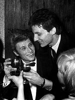 0170821 © Granger - Historical Picture ArchiveJOHNNY HALLYDAY (1943-). Hugh Aufray congratulating by Johnny Hallyday after he received a prize (Golden Disc) at the club Saint-Hilaire, Paris, November 18, 1965.  Full credit: Claude Schwartz - Rue des Archives / Granger, NYC -- All right