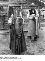 0074834 © Granger - Historical Picture ArchiveNATIVE AMERICAN: KUTENAI.   Members of the Kutenai, a Native American tribe, inhabiting parts of southeast British Columbia, northeast Washington, and northern Idaho. A papoose, carried in the traditional manner, cries on its mother's back.