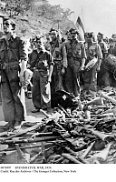 0076997 © Granger - Historical Picture ArchiveSPANISH CIVIL WAR, 1939.   Republican (Loyalist) soldiers marching across the Pyrenees frontier lay down their weapons before crossing the border into France towards the end of the Spanish Civil War, 10 February 1939.