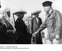 0077556 © Granger - Historical Picture ArchiveALGERIAN WAR, 1956.   Colonel de Mareuge shaking hands with a Harka (Algerian soldier serving in the French army), July 1956.