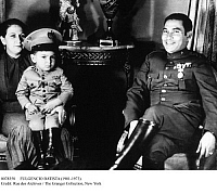 0078358 © Granger - Historical Picture ArchiveFULGENCIO BATISTA (1901-1973).   Cuban soldier and dictator. Photographed with his wife and son, c1944.