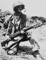 0078498 © Granger - Historical Picture ArchiveWW II: GUADALCANAL, 1943.   An American soldier on the 'Grassy Knoll' during the Guadalcanal Campaign in the Solomon Islands. Photograph, January 1943.