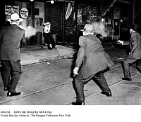 0081261 © Granger - Historical Picture ArchiveJOHN DILLINGER (1903-1934).   American bank robber. Three FBI special agents take part in a Warner Brothers reenactment of the July 1934 gun battle where Dillinger, here portrayed by an actor, was fatally shot.
