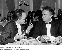 0082304 © Granger - Historical Picture ArchiveFELLINI AND de LAURENTIS.   Italian film director Federico Fellini (1920-1993), right, with producer Dino de Laurentis (1919- ). Photograph, 7 June 1963.