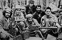 0083082 © Granger - Historical Picture ArchiveERNESTO 'CHE' GUEVARA   (1928-1967). Argentinian revolutionary leader and politician. Guevara (center, behind machine gun), showing weapons captured from Fulgencio Batista's Cuban army by Fidel Castro's revolutionaries in their raid on the Moncada barracks on 26 July 1953.