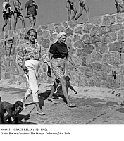 0086813 © Granger - Historical Picture ArchiveGRACE KELLY (1928-1982).   American actress and princess of Monaco, 1956-1982. In the company of her sister Lizanne LeVine and her poodle. Photographed in Ajaccio, Corsica, 1954.