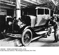 0086880 © Granger - Historical Picture ArchiveFORD ASSEMBLY LINE, c1930.   Model A assembly line at a Ford automobile plant, c1930.