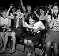 0087706 © Granger - Historical Picture ArchiveBEATLES FANS, 1964.   Fans during a Beatles concert at the Olympia Theater in Paris, France, 1964.