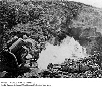 0088221 © Granger - Historical Picture ArchiveWORLD WAR II: IWO JIMA.   An American solider attacking a Japanese stronghold in a cave with a flamethrower during the Battle of Iwo Jima, 1945.