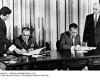 0089179 © Granger - Historical Picture ArchiveNIXON AND BREZHNEV, 1973.   Soviet leader Leonid Brezhnev (left) and U.S. President Richard Nixon signing agreements on limiting nuclear weapons, Washington, D.C., 21 June 1973.
