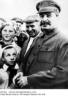 0107434 © Granger - Historical Picture ArchiveSTALIN AND KRUSHCHEV, c1935.   Soviet leader Joseph Stalin (right) photographed c1935 with Communist Party official Nikita Khrushchev and members of Young Pioneers, a Communist youth organization.