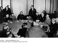 0107530 © Granger - Historical Picture ArchiveYALTA CONFERENCE, 1945.   Soviet Premier Joseph Stalin (left, in light uniform) and U.S. President Franklin Roosevelt (right, in light suit) at the conference table in the Livadia Palace at Yalta, Crimea, during the Yalta Conference, February 1945. Seated next to Roosevelt (left-to-right) are General George Marshall and Admiral William Leahy.