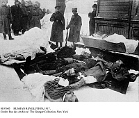 0107605 © Granger - Historical Picture ArchiveRUSSIAN REVOLUTION, 1917.   Russian government soldiers standing guard by the bodies of demonstrators, killed while protesting czarist rule during the February Revolution (March 1917) in Petrograd.