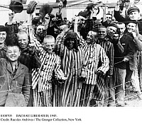 0108705 © Granger - Historical Picture ArchiveDACHAU LIBERATED, 1945.   Inmates of the Nazi concentration camp at Dachau, near Munich, Germany, greeting their American liberators, 29 April 1945, near the end of World War II.