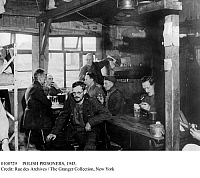 0108729 © Granger - Historical Picture ArchivePOLISH PRISONERS, 1945.   Polish officers photographed at a prison camp in Dössel, Germany, at the time of its liberation by U.S. troops in April 1945, near the end of World War II, in a room where sixty of them had been lodged.