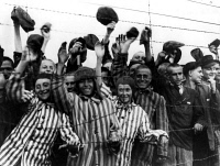 0108796 © Granger - Historical Picture ArchiveDACHAU LIBERATED, 1945.   Inmates of the Nazi concentration camp at Dachau, near Munich, Germany, greeting their American liberators, 29 April 1945, near the end of World War II.