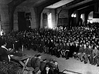 0108820 © Granger - Historical Picture ArchiveBUCHENWALD LIBERATED, 1945.   One month after being liberated by American troops, Jewish inmates at the Nazi concentration camp at Buchenwald, Germany, attend services in observance of the Jewish holiday of Shavuot, conducted by U.S. Army Chaplain Herschel Schacter (left), 18 May 1945.