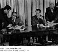 0109006 © Granger - Historical Picture ArchiveNIXON AND BREZHNEV, 1973.   Soviet leader Leonid Brezhnev (left) and U.S. President Richard Nixon signing agreements on limiting nuclear weapons, Washington, D.C., 21 June 1973.