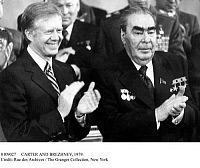 0109027 © Granger - Historical Picture ArchiveCARTER AND BREZHNEV, 1979.   U.S. President Jimmy Carter (left) and Soviet leader Leonid Brezhnev applaud the signing of the SALT II treaty on limiting strategic nuclear weapons at the summit in Vienna, Austria, 18 June 1979.