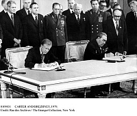 0109031 © Granger - Historical Picture ArchiveCARTER AND BREZHNEV, 1979.   U.S. President Jimmy Carter (left) and Soviet leader Leonid Brezhnev signing the SALT II treaty on limiting strategic nuclear weapons at a summit in Vienna, Austria, 18 June 1979. Standing beside each other at left are (left-to-right) U.S. Secretary of State Cyrus Vance and Soviet Foreign Minister Andrei Gromyko.