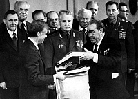 0109033 © Granger - Historical Picture ArchiveCARTER AND BREZHNEV, 1979.   U.S. President Jimmy Carter (left) and Soviet leader Leonid Brezhnev exchanging signed copies of the SALT II treaty on limiting strategic nuclear weapons, at the conclusion of their summit in Vienna, Austria, 18 June 1979. Standing at left is Soviet Foreing Minister Andrei Gromyko.