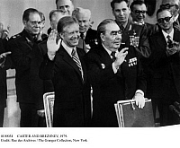 0109034 © Granger - Historical Picture ArchiveCARTER AND BREZHNEV, 1979.   U.S. President Jimmy Carter and Soviet leader Leonid Brezhnev acknowledging applause after signing the SALT II treaty on limiting strategic nuclear weapons at the conclusion of their summit in Vienna, Austria, 18 June 1979.