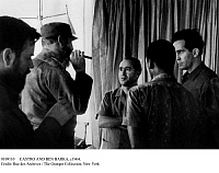 0109110 © Granger - Historical Picture ArchiveCASTRO AND BEN BARKA, c1964.   Premier Fidel Castro of Cuba (second from left, with cigar), receives the exiled Moroccan opposition leader Mehdi Ben Barka (center), founder of the National Union of Popular Forces, c1964.