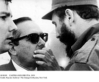 0109149 © Granger - Historical Picture ArchiveCASTRO AND URRUTIA, 1959.   Cuban revolutionary leader Fidel Castro (right) and Cuba's new president, Manuel Urrutia (center), photographed at the presidential palace in Havana, 8 January 1959, one week after the overthrow of the dictatorship of Fulgencio Batista.