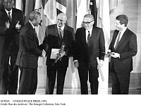 0109241 © Granger - Historical Picture ArchiveUNESCO PEACE PRIZE, 1991.   Nelson Mandela (left), head of the African National Congress, and South African President Frederik Willem de Klerk shake hands as joint recipients of the UNESCO Peace Prize, during the award ceremony in Paris, France, 1991. Looking on are Federico Mayor, Director General of UNESCO (right), and Henry Kissinger, prize jury member.