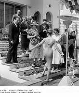 0109289 © Granger - Historical Picture ArchiveCANNES FILM FESTIVAL, 1956.   French Minister of Justice François Mitterrand (left, on third step) and his wife Danielle (in striped shirt) photographed with actresses Edwige Feuillère (in stole) and Brigitte Bardot (back to the camera) while attending the Cannes Film Festival, 24 April 1956. EDITORIAL USE ONLY; RESTRICTED OUTSIDE US.