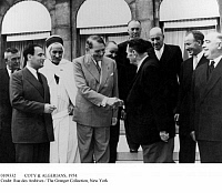 0109332 © Granger - Historical Picture ArchiveCOTY & ALGERIANS, 1954.   French President René Coty (center, in light suit) greeting representatives of the Algerian Assembly in Paris, 5 August 1954, a few months prior to the outbreak of the Algerian War of Independence. Standing at left, in foreground, is Interior Minister François Mitterrand.