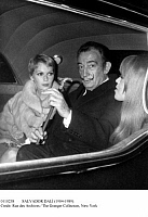 0110238 © Granger - Historical Picture ArchiveSALVADOR DALÍ (1904-1989).   Spanish painter. Dali on his way to a charity benefit in Paris, 20 April 1970, accompanied by American actress Mia Farrow, left, and his protege, Amanda Lear.