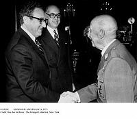 0110382 © Granger - Historical Picture ArchiveKISSINGER AND FRANCO, 1973.   U.S. Secretary of State Henry Kissinger, left, is greeted by General Francisco Franco in Madrid, 22 December 1973. In the background is Laureano Lopez Rodo, member of Opus Dei.